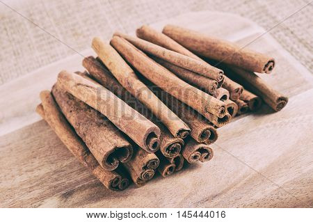 Cinnamon Sticks On Cutting Board With Faded Effect