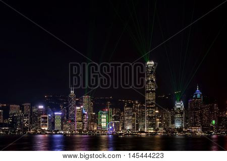 Hong Kong Harbor Skyscraper Bathed in Colored Lights and Lasers