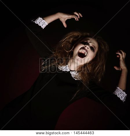 Portrait of a scared screaming young woman