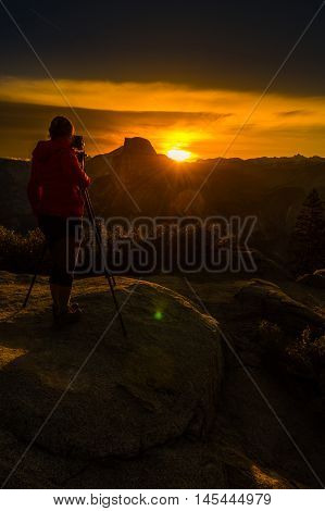 Photographer Taking Pictures Of Sunrise Yosemite National Park Glacier Point