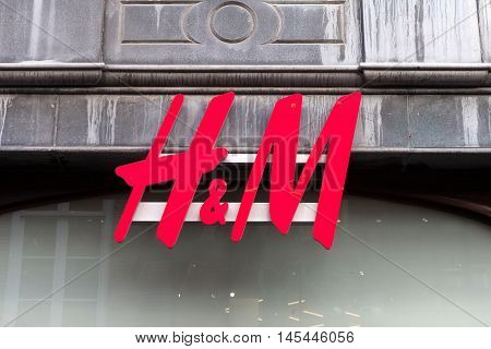 Amsterdam, The Netherlands, August 30, 2016: H&M sign. H&M is a Swedish multinational clothing-retail company, known for its fast-fashion clothing for men, women, teenagers and children
