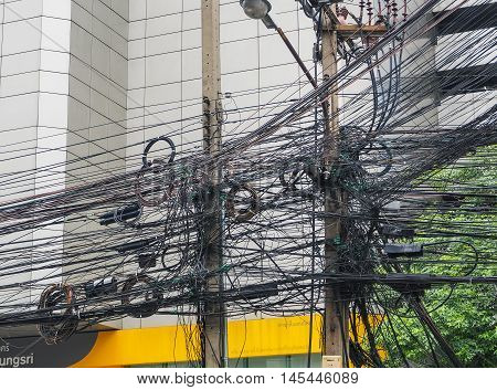 BANGKOK: August 23: The chaos of cables and wires on asoke road on August 23, 2016 in Bangkok, Thailand.