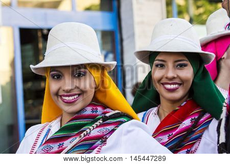 QUARTU S.E., ITALY - July 15, 2016: 30th Sciampitta - International festival of folklore - Folk Ballet de la Universidad La Paz (Bolivia) - Sardinia - portrait of beautiful smiling girls