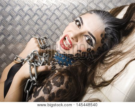 young sexy woman with leopard make up all over body, cat bodyart print closeup sensual