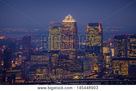 London England - Skyline view of the skyscrapers of Canary Wharf the leading business district of London at blue hour