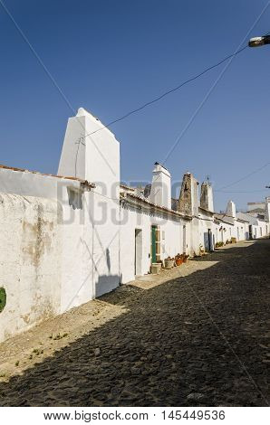 street of evoramonte a small village in alentejo. small white traditional houses