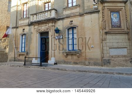 Mdina, Malta - August 04 2016: Mdina police station entrance. Facade of the police station inside the walls of the Silent City.