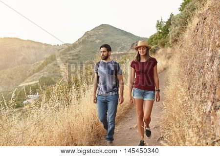 Nice Young Couple Strolling Down Mountain