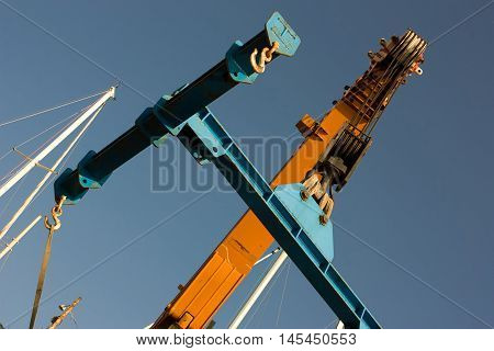 two cranes build something on the blu