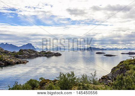 Lofoten coastline near Svolvaer, Norway. Lofoten archipelago is known for a distinctive scenery with dramatic mountains and peaks, open sea and sheltered bays, beaches and untouched lands.