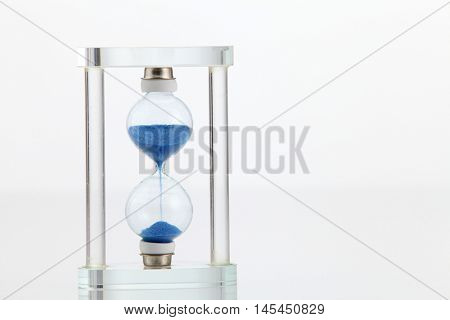 crystal hourglass on the white background