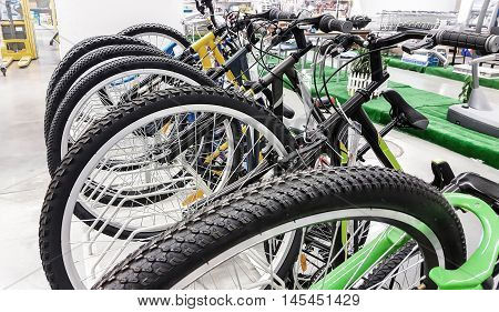 Row of bikes available to sell  in the shop.