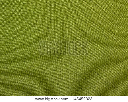green knitted fabric , knitted texture green fabric close-up
