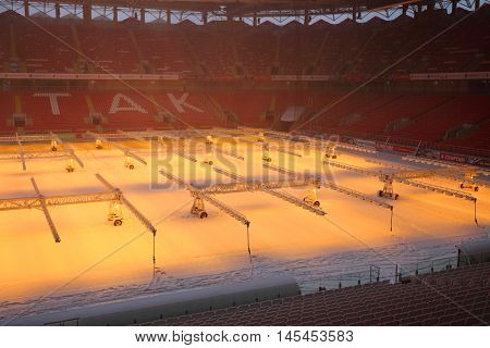 MOSCOW - DEC 25, 2014: Lamps on field in Spartak stadium at winter. New stadium is included in list of objects for games will be played at 2018 World Cup