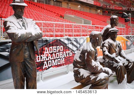 MOSCOW - DEC 25, 2014: Monument to Starostin brothers in Spartak stadium during snowfall. New stadium is included in list of objects for games will be played at 2018 World Cup