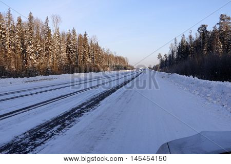 Road In Snow In Cold Winter Day
