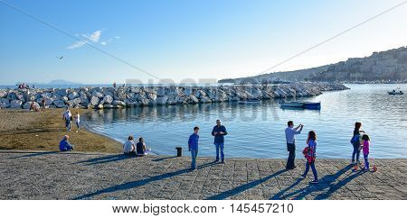 NAPLES, ITALY - OCTOBER 04: View of seafront of Naples from Via Caracciolo. Taken in October 04, 2015 in Naples, Italy.