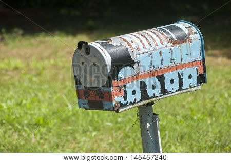 American outdoor metal mailbox on wooden support
