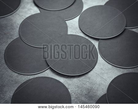 Many black circle beer coasters on a gray floor. 3d rendering