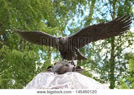Bronze Eagle Taking Off A Stone Monument