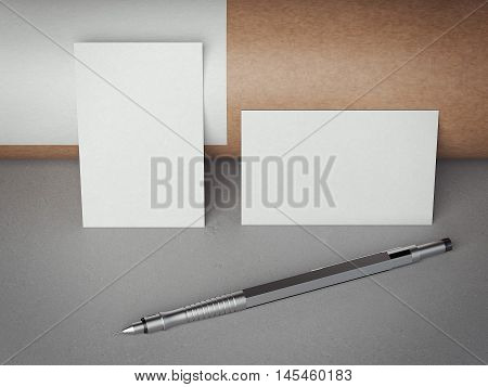 Two white blank business cards with pen on gray floor. 3d rendering