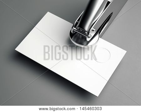 Metal embosser with blank business card on gray floor. 3d rendering