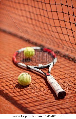 Tennis racket and balls postpone at tennis court