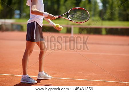 Female tennis player serving tennis balls - body part
