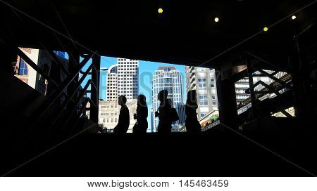 Four shadow people slowly walking in Seattle
