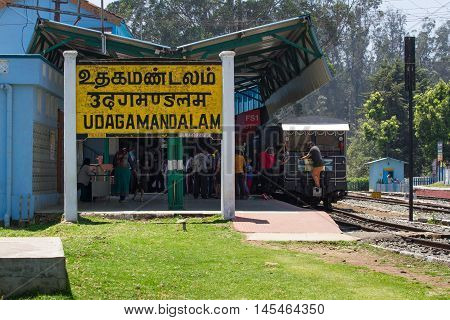 OOTY, TAMIL NADU, INDIA, 22 March 2015 : Nilgiri region. Railroad sign Udagamanadalam written in Tamil official language of Tamilnadu , Hindi and English on a platform of the railway station