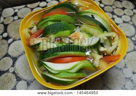 appetizing, bright colorful vegetable mix sqaush cut on slices, tomato, pepper light snack