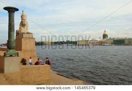 SAINT-PETERSBURG RUSSIA - AUGUST 25 2016: The Neva River and Lieutenant Schmidt Embankment in St. Petersburg