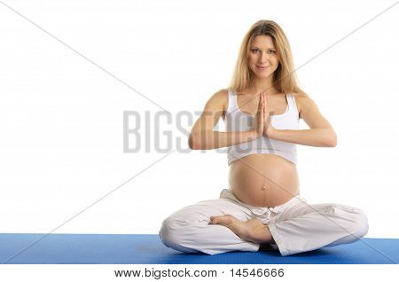 Pregnant woman practicing yoga, sitting