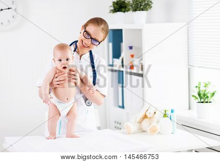 Doctor pediatrician and baby patient in clinic