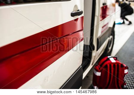 emergency medical rucksack and ambulance for an accident