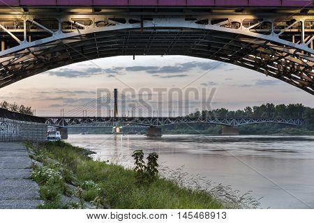 Swietokrzystki bridge over Vistula river during sundown Warsaw Poland