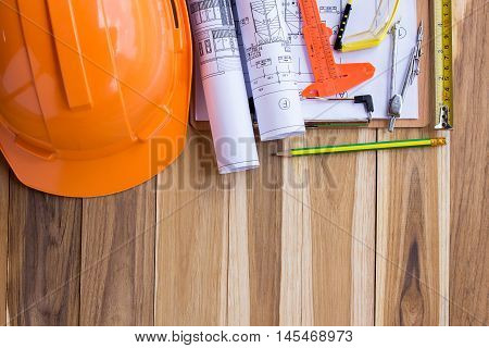 Safety equipmenttool kit and plan construction on wooden table background with copy space