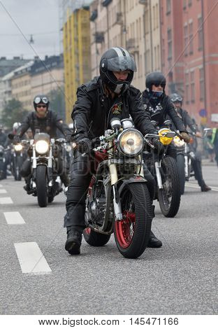 STOCKHOLM SWEDEN - SEPT 03 2016: Closeup of old fashioned motorcycles and bikers at the Mods vs Rockers event at the Saint Eriks bridge Stockholm Sweden September 03 2016