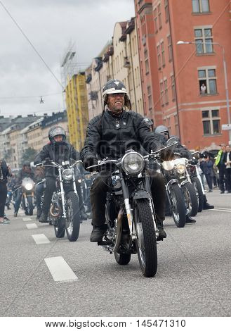 STOCKHOLM SWEDEN - SEPT 03 2016: Group of senior bikers on old fashioned motorcycles at the Mods vs Rockers event at the St:Eriks bridge Stockholm Sweden September 03 2016