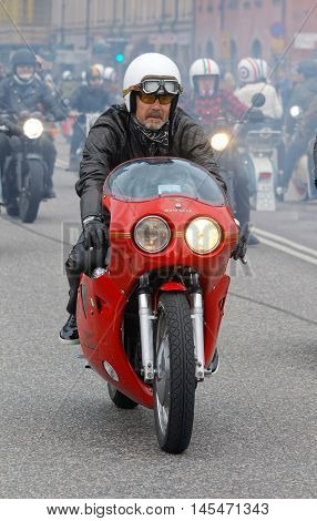 STOCKHOLM SWEDEN - SEPT 03 2016: Biker wearing leather clothes on old fashioned motorcycle at the Mods vs Rockers event at the St:Eriks bridge Stockholm Sweden September 03 2016