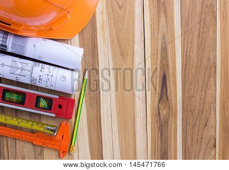 Architecture plan and rolls of blueprints with tool kit for the project engineer jobs