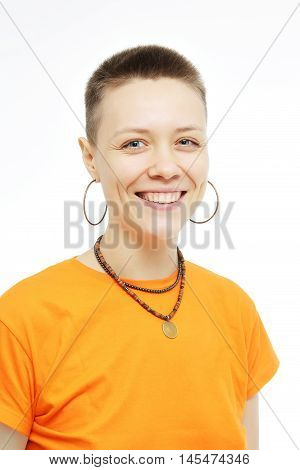 Close-up portrait of smiling beautiful girl. Over white background. Smiling girl in an orange T-shirt. Age defying skin care anti aging flawless spa treatment beautiful woman smiles