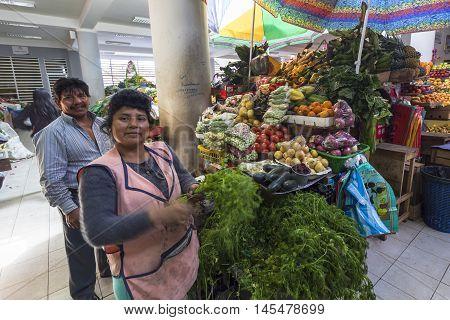 Píllaro ECUADOR - FEBRUARY 6 2016: Unidentified couple sells vegetables in the market Pillaro.