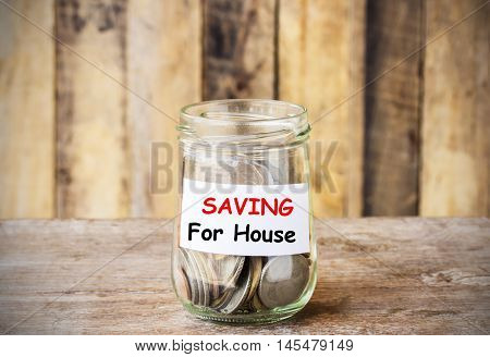 Text for SAVING for house concept money in the glass with filter effect retro vintage style