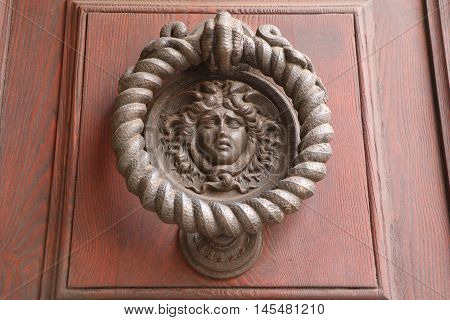 Old and ancient knocker in the city of Rome