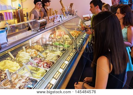 Florence Italy - July 03 2016: ice cream shop in Florence with unidentified people. Italy is well known for its ice cream production escpecially this one made in manual craft