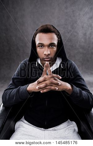 African American Man Sitting In Casual Clothes