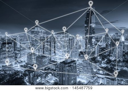 Bangkok night view in business district with map pin flat network above Bangkok city with network connection concept