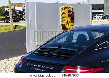 Indianapolis - Circa September 2016: Local Porsche Dealership Displaying a New 911. Porsche Racing Dates to the 1950s I