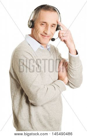 Old call center man wearing headset